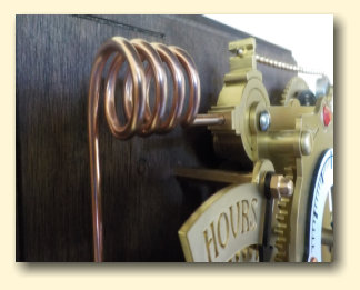 Coiled copper pipe on the steampunk Chronograph pendulum clock