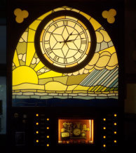 Illuminated clock with stained glass from steampunk weather station