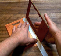 Carefully use the ruler to fold over each of the middle folds