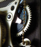 Brass ball chain and simulated drive spring on the steampunk clock